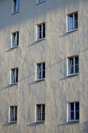sidelight: Facade of a building with several windows, sidelight, outdoor