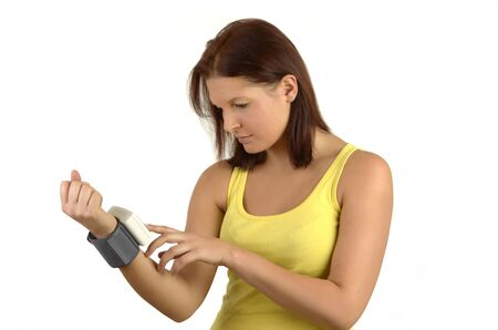 blood sport: Young sporty woman in a yellow tank top controls blood sugar levels on the meter