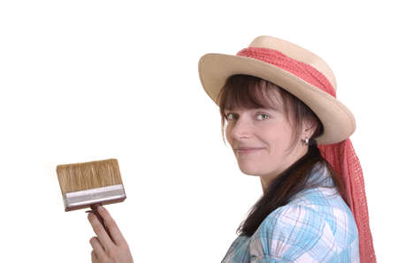 open minded: Young artist is holding  brush and smiles into camera, isolated, white background