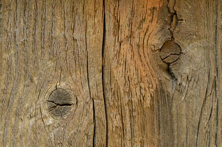 knothole: closeup of wooden board with two knotholes, outdoor, background Stock Photo