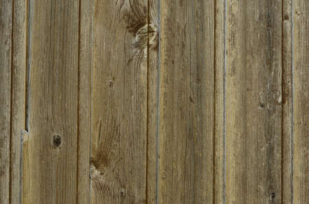 knothole: detail of a weathered wooden door, outdoor, background