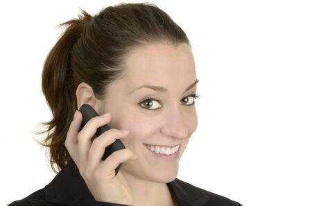 business woman with smart phone talking before white background, stuido shot, isolated photo