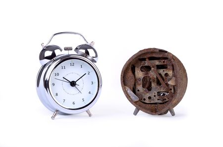 A new and an old alarm clock, isolated, studio still photo