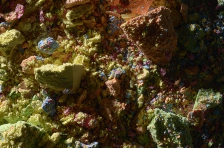 sidelight: mixed multicolored chalk dust and pieces, studio shot, closeup