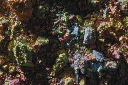 basic scheme: mixed multicolored chalk dust and pieces, studio shot, closeup