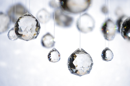 mood moody: crystal balls hanging on nylon strings, studio shot Stock Photo