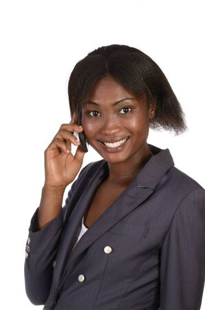 African Business Woman talking in cellphone, studio shot photo