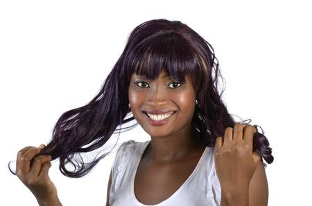 Pretty african girl holding hair, studio shot