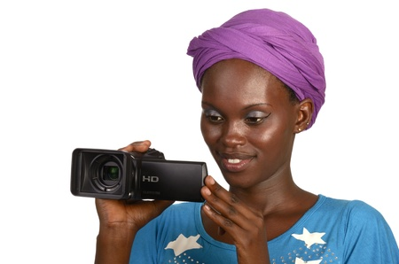 maker: Pretty african girl smiling with video camera, Studio shot