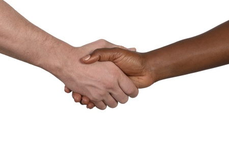 shake hand: African and european handshake, studio shot, isolated