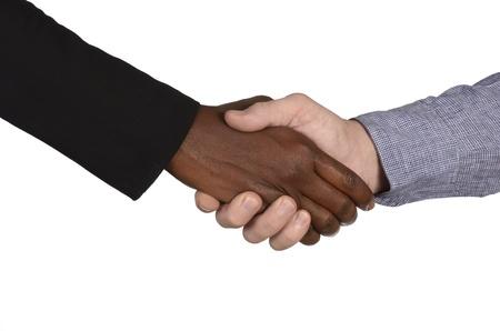 fair skinned: African and european handshake, studio shot, isolated