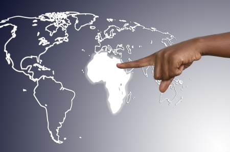 world market: Finger is touching african continent on virtual map Stock Photo