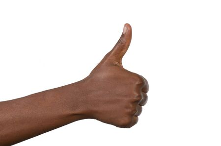 Female fist thumbs up, studio shot, isolated photo