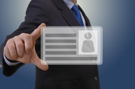 Business man showing virtual business card, studio shot
