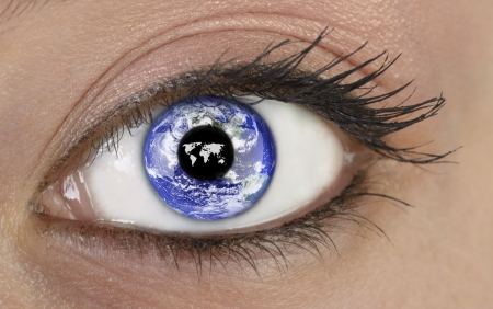 holistic view: Eye with planet earth, montage Stock Photo