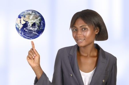 African business woman with world, studio shot photo