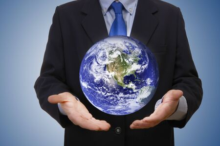 Business man holding planet, studio shot Stock Photo - 18424693