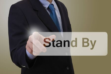 pause button: Business man touching touchscreen with message - Stand By Stock Photo