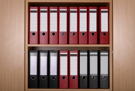 file cabinet: Different Files in office cupboard, close up