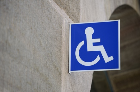 Wheelchair sign on wall in urban context photo