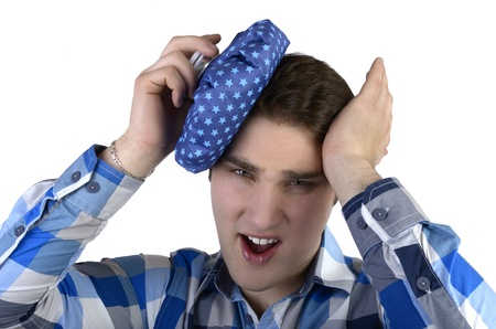Young man in blue shirt has bad headache photo