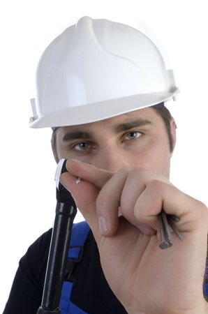 Young construction worker with hammer and nails Stock Photo - 20045906