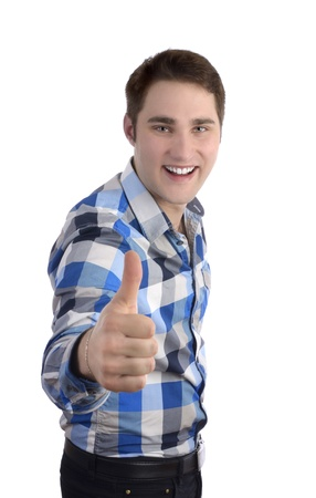 affirm: Young smilling man in blue shirt, thumb up, Studio Shot Stock Photo