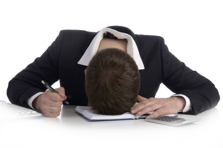 burnt out: Burnt out business man in office Stock Photo