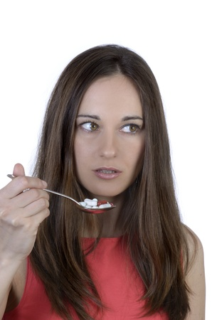 Pretty woman with spoon of pills, Studio Shot Stock Photo - 20078128
