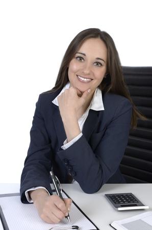 Pretty business woman on office desk, Studio Shot photo