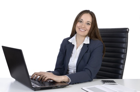Pretty business woman on office desk, Studio Shot Stock Photo - 20078050