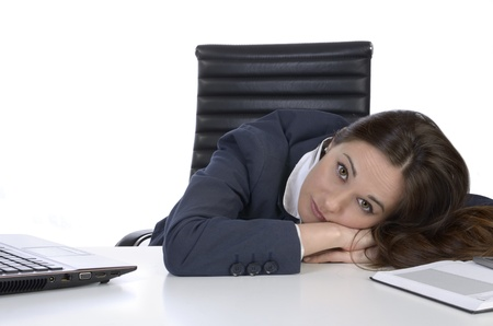 exploited: Pretty business woman in uncomfortable situation, Studio Shot Stock Photo