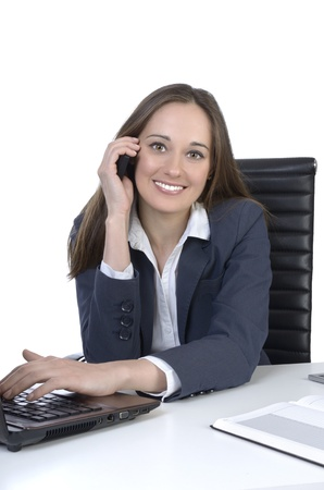 costumer: Pretty business woman calling on office desk, Studio Shot Stock Photo