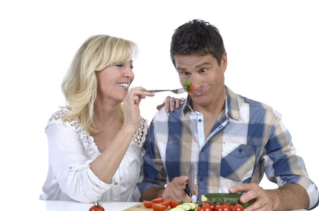 Happy mature couple having fun while cooking, Studio Shot Stock Photo - 20334970