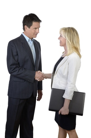 Business man and woman shaking hands, Studio Shot photo