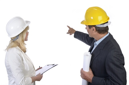 Male and female architect looking at background Stock Photo - 20362658