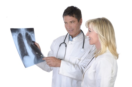 Doctor and female patient talking about x-ray of lungs photo