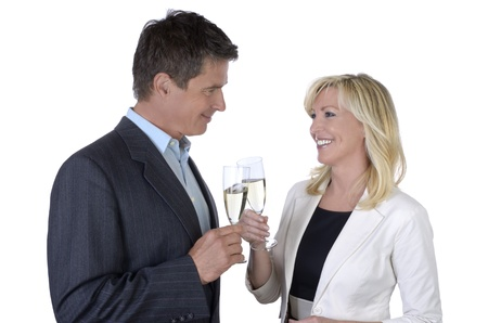 Male and female business people celebrating with Champagne photo