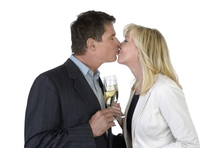 women kissing women: Man and woman kissing and celebrating with Champagne