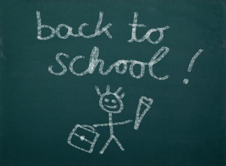School kid s drawings on green blackboard, writing   back to school    photo