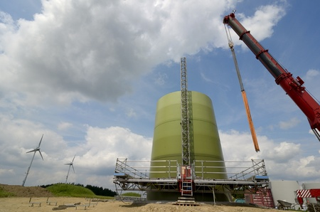 Wind turbine at beginning of construction, foundation and first segments, Germany, July 2013 Stock Photo - 20908552