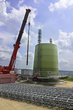 Wind turbine at beginning of construction, foundation and first segments, Germany, July 2013 Stock Photo - 20908554