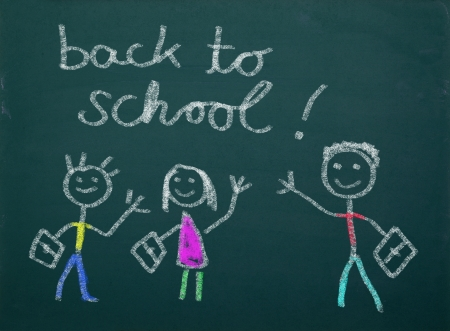 School kid s drawings on green blackboard, writing   back to school    photo