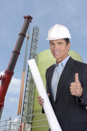 Male architect at construction site smiling and thumb up, outdoor photo