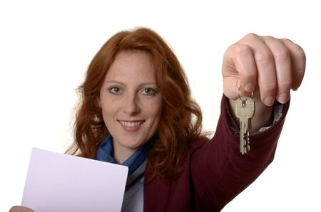 gives: Woman with keys smiling, Studio Shot