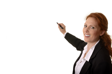 charismatic: Pretty red-haired business woman writing with pen, Studio Shot