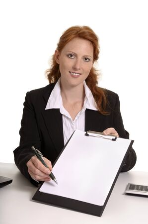 Pretty red-haired business woman with contract, Studio Shot photo
