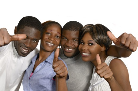 Four african friends showing thumbs up, Studio Shot