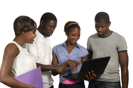 Four african friends looking at tablet PC, Studio Shot photo