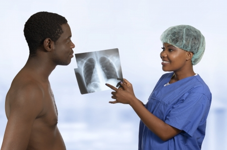 African Doctor explaining X-Ray image to Patient, Studio Shot photo